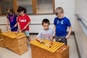 Kids playing orff instruments