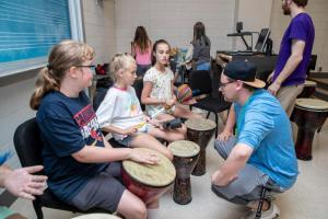 Campers playing percussion instruments