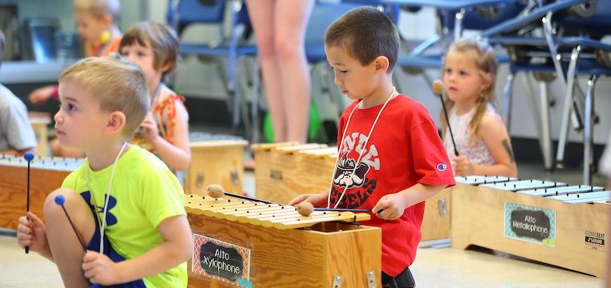 Kids playing the xylophone